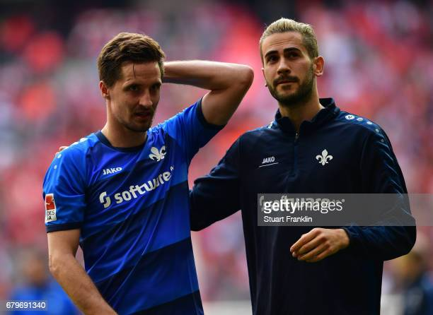 Sandro Sirigu and Mario Vrancic of Dramstadt look dejected after their team got relagated after the Bundesliga match between Bayern Muenchen and SV...