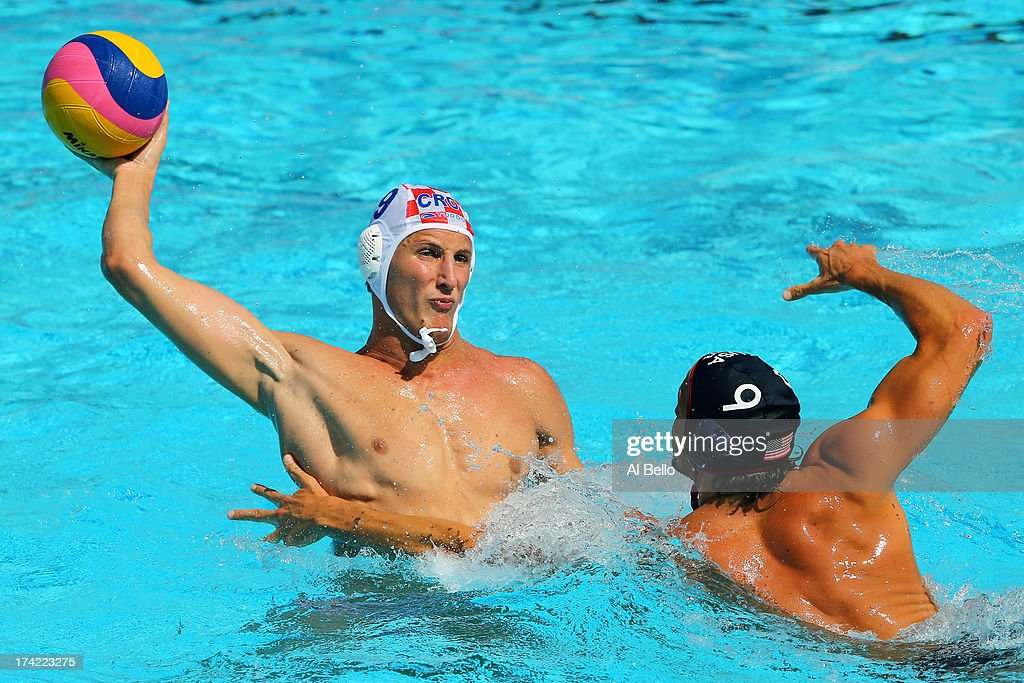 Sandro Sukno of Croatia looks to pass the ball under pressure from Shea Buckner of USA during the Men's Water Polo first preliminary round match between USA and Croatia during day three of the 15th FINA World Championships at Piscines Bernat Picornell on July 22, 2013 in Barcelona, Spain.