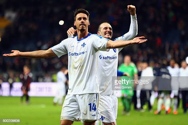 Sandro Wagner and Luca Caldirola of Darmstadt celebrate with the fans after the Bundesliga match between Eintracht Frankfurt and SV Darmstadt 98 at...