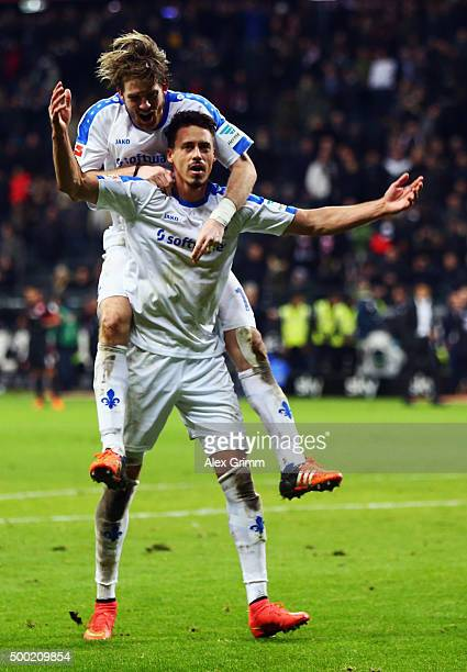 Sandro Wagner and Peter Niemeyer of Darmstadt celebrate with the fans after the Bundesliga match between Eintracht Frankfurt and SV Darmstadt 98 at...