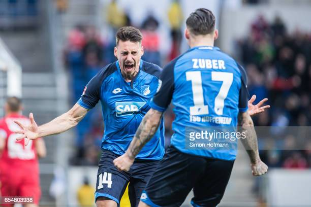 Sandro Wagner and Steven Zuber of Hoffenheim celebrates his team's first goal during the Bundesliga match between TSG 1899 Hoffenheim and Bayer 04...