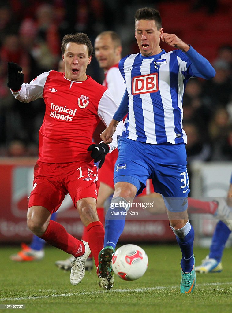 <a gi-track='captionPersonalityLinkClicked' href=/galleries/search?phrase=Sandro+Wagner&family=editorial&specificpeople=595390 ng-click='$event.stopPropagation()'>Sandro Wagner</a> (R) of Berlin battles for the ball with Alexander Bittroff (L) of Cottbus during the Second Bundesliga match between FC Energie Cottbus and Hertha BSC Berlin at Stadion der Freundschaft on December 3, 2012 in Cottbus, Germany.