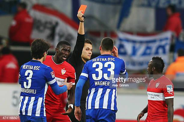 Sandro Wagner of Berlin is sent off by referee Robert Hartmann during the Bundesliga match between VfB Stuttgart and Hertha BSC Berlin at...