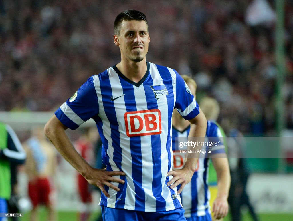 Sandro Wagner of Berlin looks dejected after loosing the DFB Cup 2nd round match between 1.FC Kaiserslautern and Hertha BSC Berlin at Fritz-Walter-Stadion on September 25, 2013 in Kaiserslautern, Germany.