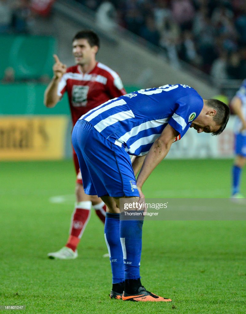 <a gi-track='captionPersonalityLinkClicked' href=/galleries/search?phrase=Sandro+Wagner&family=editorial&specificpeople=595390 ng-click='$event.stopPropagation()'>Sandro Wagner</a> of Berlin looks dejected after loosing the DFB Cup 2nd round match between 1.FC Kaiserslautern and Hertha BSC Berlin at Fritz-Walter-Stadion on September 25, 2013 in Kaiserslautern, Germany.