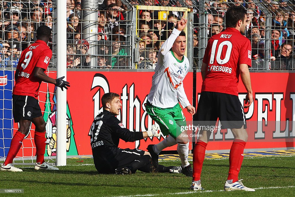 <a gi-track='captionPersonalityLinkClicked' href=/galleries/search?phrase=Sandro+Wagner&family=editorial&specificpeople=595390 ng-click='$event.stopPropagation()'>Sandro Wagner</a> (2R) of Bremen celebrates his team's first goal as Papiss Demba Cisse, goalkeeper Oliver Baumann and <a gi-track='captionPersonalityLinkClicked' href=/galleries/search?phrase=Maximilian+Nicu&family=editorial&specificpeople=764029 ng-click='$event.stopPropagation()'>Maximilian Nicu</a> (L-R) of Freiburg react during the Bundesliga match between SC Freiburg and SV Werder Bremen at Badenova Stadium on March 6, 2011 in Freiburg im Breisgau, Germany.