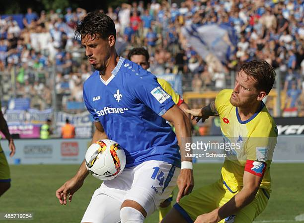 Sandro Wagner of Darmstadt and Pavel Kaderabek of Hoffenheim fight for the ball during the Bundesliga match between SV Darmstadt 98 and 1899...