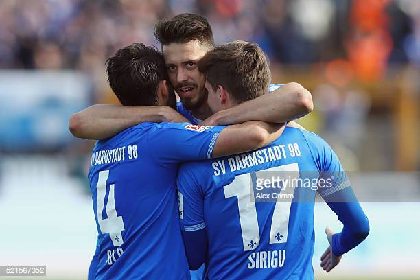Sandro Wagner of Darmstadt celebrates his team's second goal with team mates Aytac Sulu and Sandro Sirigu during the Bundesliga match between SV...