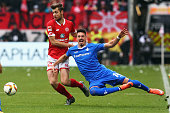 Sandro Wagner of Darmstadt is challenged by Alexander Hack of Mainz during the Bundesliga match between 1 FSV Mainz 05 and SV Darmstadt 98 at Coface...