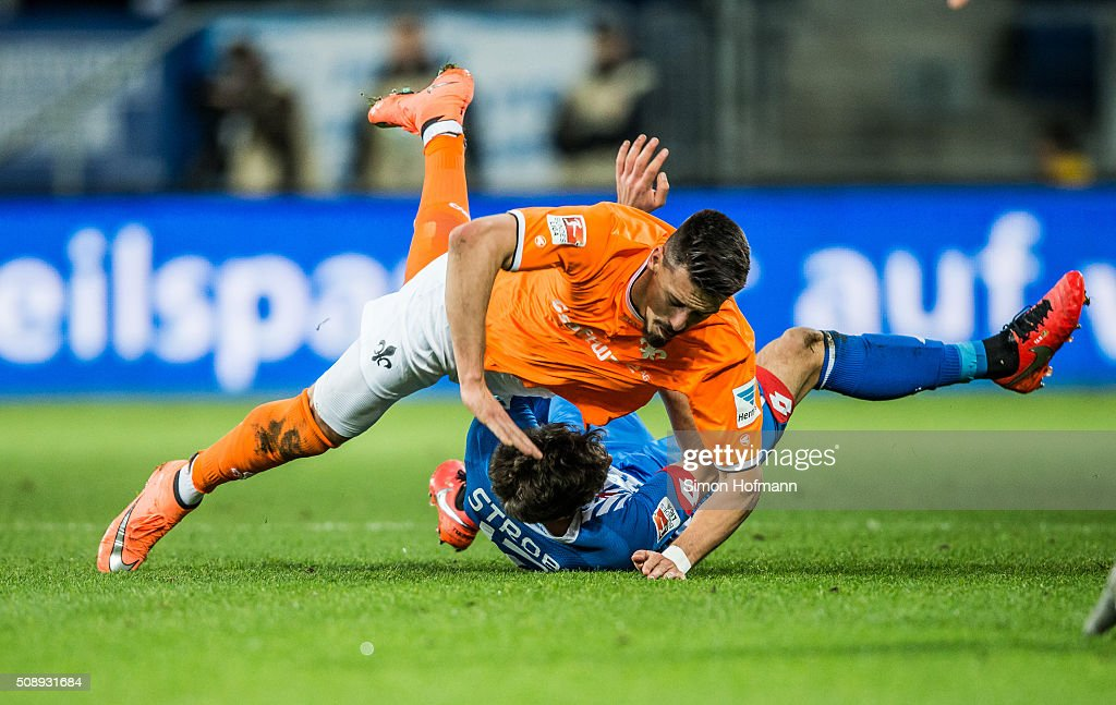 <a gi-track='captionPersonalityLinkClicked' href=/galleries/search?phrase=Sandro+Wagner&family=editorial&specificpeople=595390 ng-click='$event.stopPropagation()'>Sandro Wagner</a> of Darmstadt is challenged by Tobias Strobl of Hoffenheim during the Bundesliga match between 1899 Hoffenheim and SV Darmstadt 98 at Wirsol Rhein-Neckar-Arena on February 7, 2016 in Sinsheim, Germany.