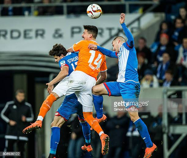 Sandro Wagner of Darmstadt jumps for a header with Tobias Strobl and Pavel Kaderabek of Hoffenheim during the Bundesliga match between 1899...