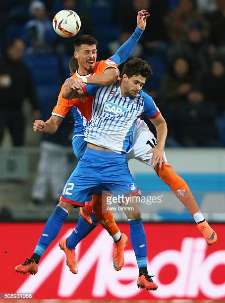 Sandro Wagner of Darmstadt jumps for a header with Tobias Strobl of Hoffenheim during the Bundesliga match between 1899 Hoffenheim and SV Darmstadt...