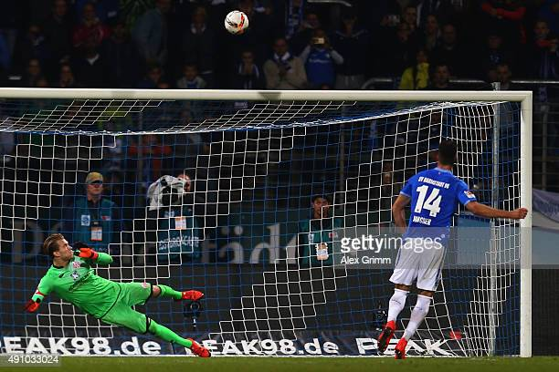 Sandro Wagner of Darmstadt shoots a last second penalty over the crossbar against goalkeeper Lorius Karius of Mainz during the Bundesliga match...