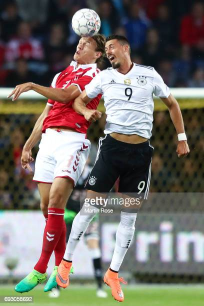 Sandro Wagner of Germany and Jannik Vestergaard of Denmark battle for the ball during the international friendly match between Denmark v Germany on...