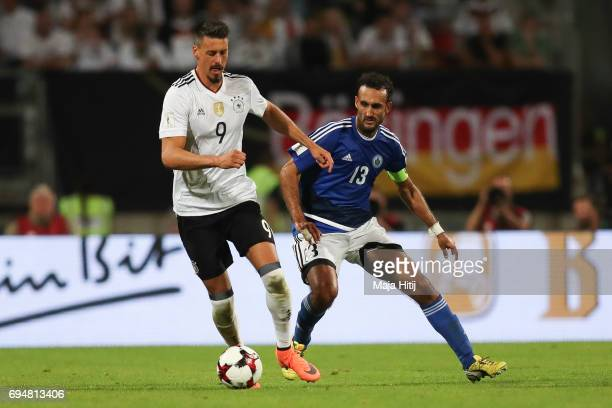 Sandro Wagner of Germany and Michele Cervellini of San Marino battle for the ball during the FIFA 2018 World Cup Qualifier between Germany and San...