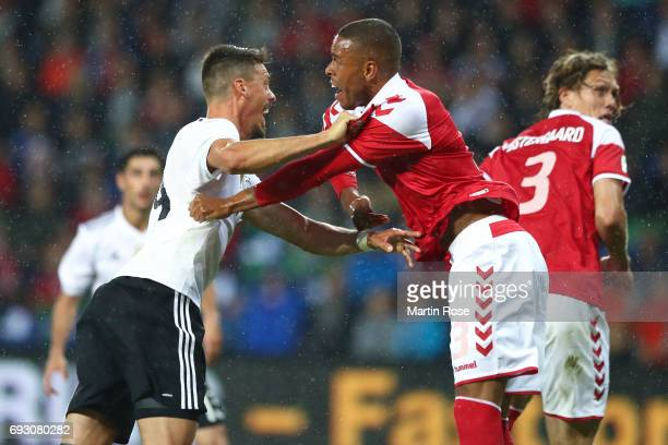 Sandro Wagner of Germany and Riza Durmisi of Denmark fight during the international friendly match between Denmark v Germany on June 6 2017 in...