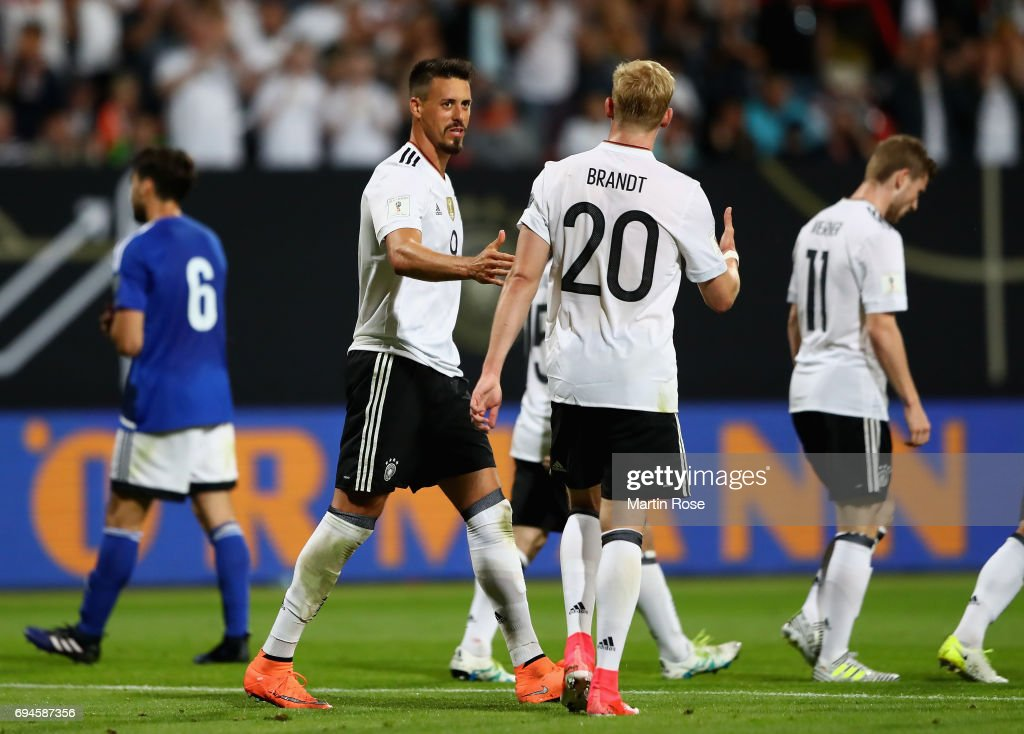 Sandro Wagner of Germany celebrates scoring his sides seventh goal with Julian Brandt of Germany during the FIFA 2018 World Cup Qualifier between Germany and San Marino at Stadion Nurnberg on June 10, 2017 in Nuremberg, Bavaria.