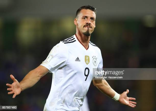 Sandro Wagner of Germany celebrates scoring the second goal during the FIFA 2018 World Cup Qualifier between Northern Ireland and Germany at Windsor...
