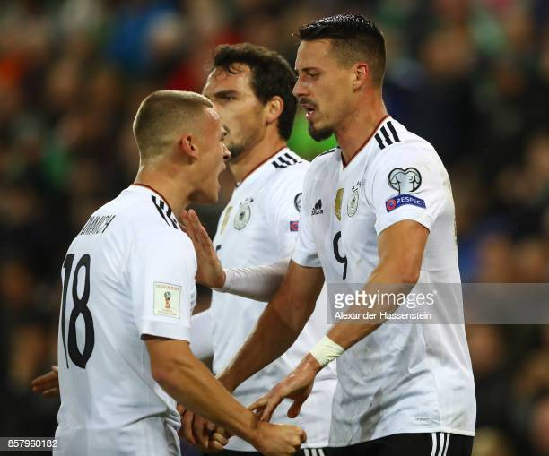 Sandro Wagner of Germany celebrates scoring the second goal with Joshua Kimmich during the FIFA 2018 World Cup Qualifier between Northern Ireland and...