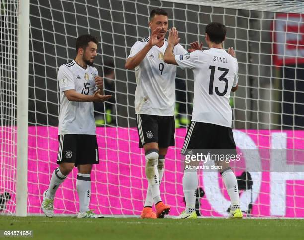 Sandro Wagner of Germany fcelebrates his second goal with teammates Amin Younes and Lars Stindl during the FIFA 2018 World Cup Qualifier between...