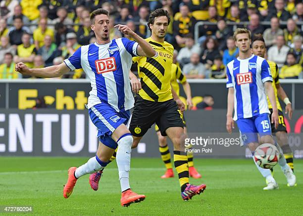 Sandro Wagner of Hertha BSC and Neven Subotic of Borussia Dortmund fight for the ball during the game between Borussia Dortmund and Hertha BSC on May...