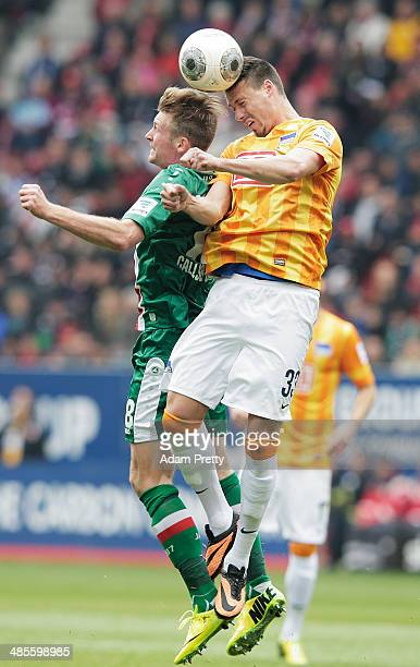 Sandro Wagner of Hertha heads the ball over JanIngwer CallsenBracker of FC Augsburg during the Bundesliga match between FC Augsburg and Hertha BSC at...