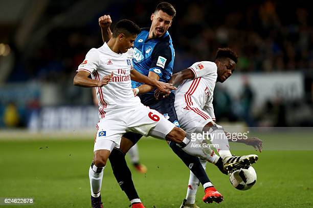 Sandro Wagner of Hoffenheim and Justino Do Santos and Gideon Jung of Hamburg battle for the ball during the Bundesliga match between TSG 1899...