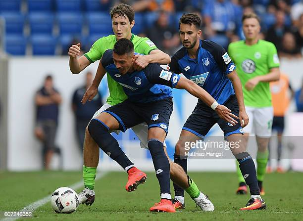 Sandro Wagner of Hoffenheim and Philipp Wollscheid of Wolfsburg compete for the ball during the Bundesliga match between TSG 1899 Hoffenheim and VfL...