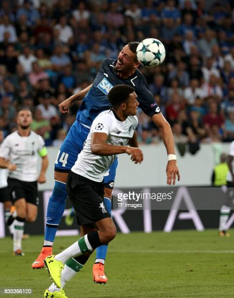 Sandro Wagner of Hoffenheim and Trent AlexanderArnold of Liverpool battle for the ball during the UEFA Champions League Qualifying PlayOffs Round...