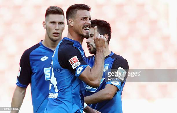 Sandro Wagner of Hoffenheim celebrates his team's first goal during the Bundesliga match between 1 FSV Mainz 05 and TSG 1899 Hoffenheim at Opel Arena...