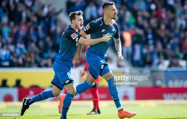 Sandro Wagner of Hoffenheim celebrates his team's first goal with team mate Havard Nordtveit during the Bundesliga match between TSG 1899 Hoffenheim...