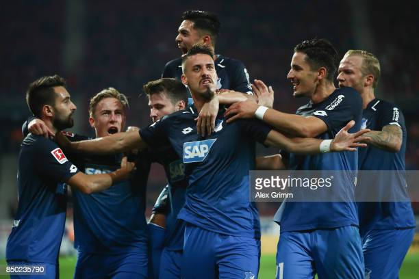 Sandro Wagner of Hoffenheim celebrates his team's second goal with team mates Lukas Rupp Felix Passlack Benjamin Huebner and Kevin Vogt during the...