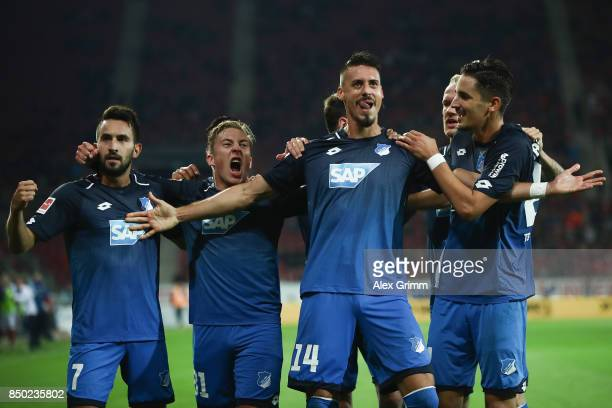 Sandro Wagner of Hoffenheim celebrates his team's second goal with team mates Lukas Rupp Felix Passlack and Benjamin Huebner during the Bundesliga...