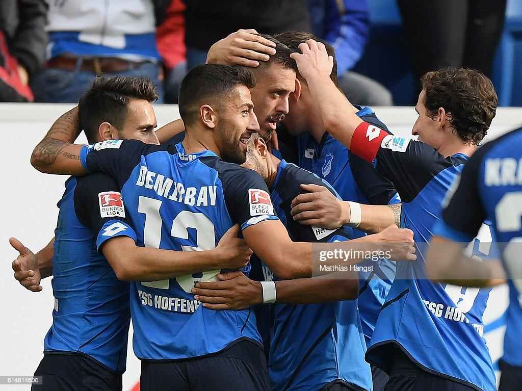 Sandro Wagner of Hoffenheim celebrates with his team-mates after scoring his team's first goal during the Bundesliga match between TSG 1899 Hoffenheim and SC Freiburg at Wirsol Rhein-Neckar-Arena on October 15, 2016 in Sinsheim, Germany.