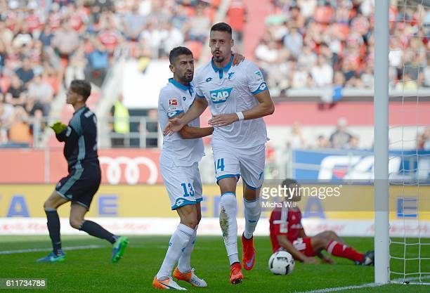 Sandro Wagner of Hoffenheim celebrates with Kerem Demirbay of Hoffenheim after scoring the opening/first goal during the Bundesliga match between FC...