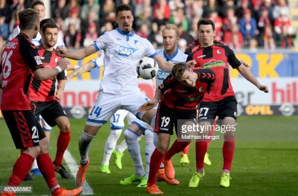 Sandro Wagner of Hoffenheim challenges Janik Haberer of Freiburg during the Bundesliga match between SC Freiburg and TSG 1899 Hoffenheim at...