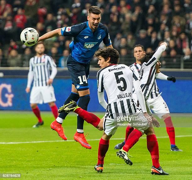 Sandro Wagner of Hoffenheim challenges Jesus Vallejo of Frankfurt during the Bundesliga match between Eintracht Frankfurt and TSG 1899 Hoffenheim at...