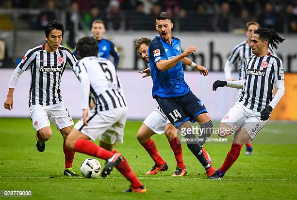 Sandro Wagner of Hoffenheim challenges Szabolcs Huszti of Frankfurt Omar Mascarell of Frankfurt Jesus Vallejo of Frankfurt during the Bundesliga...