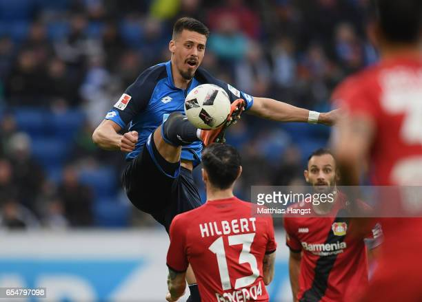 Sandro Wagner of Hoffenheim controls the ball against Roberto Hilbert of Leverkusen during the Bundesliga match between TSG 1899 Hoffenheim and Bayer...