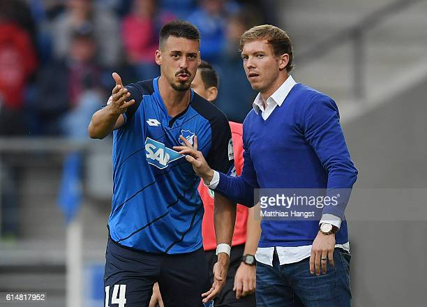 Sandro Wagner of Hoffenheim discusses with Head coach Julian Nagelsmann of Hoffenheim during the Bundesliga match between TSG 1899 Hoffenheim and SC...