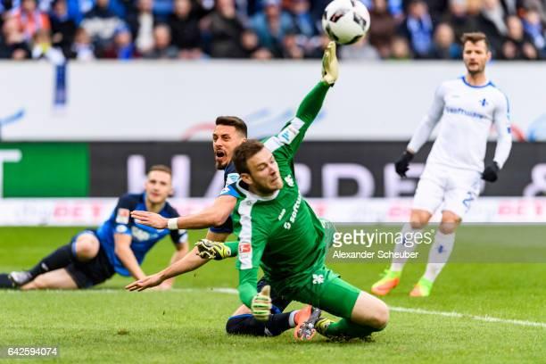 Sandro Wagner of Hoffenheim in action against Michael Esser of Darmstadt during the Bundesliga match between TSG 1899 Hoffenheim and SV Darmstadt 98...