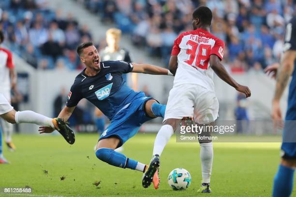 Sandro Wagner of Hoffenheim is being fouled by Caiuby of Augsburg during the Bundesliga match between TSG 1899 Hoffenheim and FC Augsburg at Wirsol...