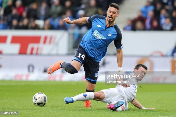Sandro Wagner of Hoffenheim is challenged by Artem Fedetsky of Darmstadt during the Bundesliga match between TSG 1899 Hoffenheim and SV Darmstadt 98...