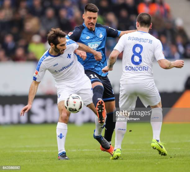 Sandro Wagner of Hoffenheim is challenged by Hamit Altintop and Jerome Gondorf of Darmstadt during the Bundesliga match between TSG 1899 Hoffenheim...