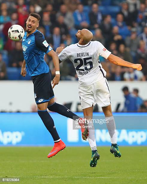 Sandro Wagner of Hoffenheim is challenged by John Anthony Brooks of Berlin during the Bundesliga match between TSG 1899 Hoffenheim and Hertha BSC at...