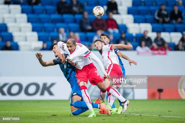 Sandro Wagner of Hoffenheim is tackled by Raul Silva of Braga during the UEFA Europa League Group C match between 1899 Hoffenheim and Sporting Braga...