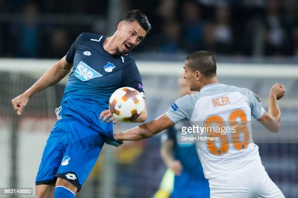Sandro Wagner of Hoffenheim jumps for a header with Goekhan Inler of Istanbul during the UEFA Europa League group C match between 1899 Hoffenheim and...