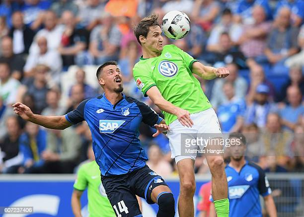 Sandro Wagner of Hoffenheim jumps for a header with Philipp Wollscheid of Wolfsburg during the Bundesliga match between TSG 1899 Hoffenheim and VfL...