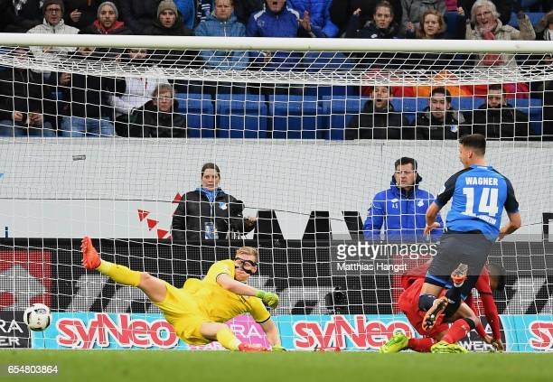 Sandro Wagner of Hoffenheim scores his team's first goal past goalkeeper Bernd Leno of Leverkusen during the Bundesliga match between TSG 1899...