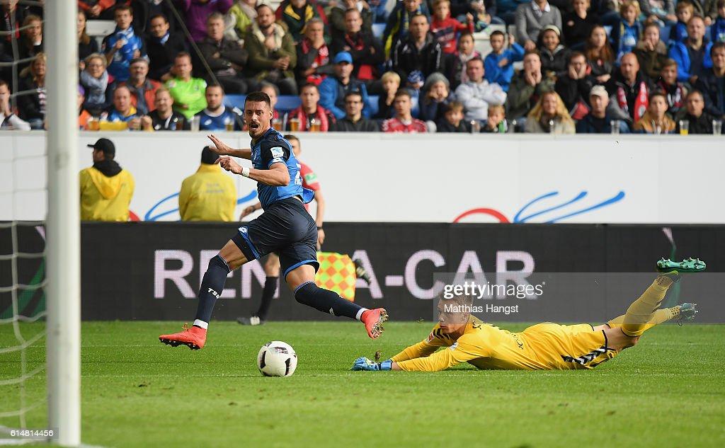 Sandro Wagner of Hoffenheim scores his team's first goal past goalkeeper Alexander Schwolow of Freiburg during the Bundesliga match between TSG 1899 Hoffenheim and SC Freiburg at Wirsol Rhein-Neckar-Arena on October 15, 2016 in Sinsheim, Germany.